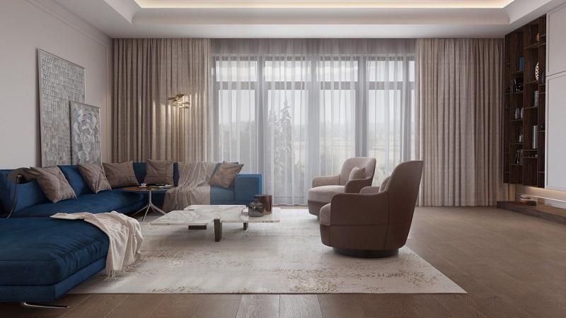 Вариант бежевого просторного зала с синим диваном
